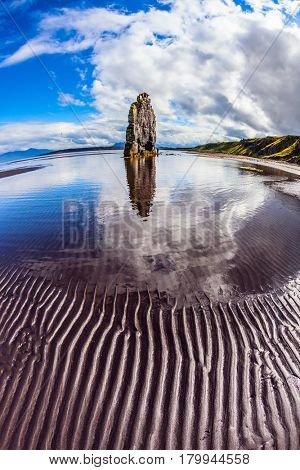 Northern coast of Iceland. Magic Rock Hvitsercur at sunset. Concept of extreme northern tourism. The picture was taken Fisheye lens