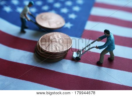 Men Moving Pennies On American Flag High Quality