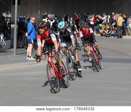 AALST, BELGIUM, APRIL 2 2017: Competitors racing in the Tour of Flanders through the streets of Aalst. It is the most important Flemish cycling event and one of the five monuments of the cycling year.