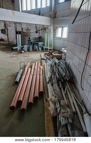 Industrial Pipes Lie On The Floor