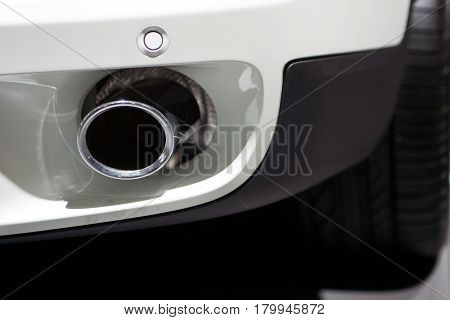 Exhaust pipes of a modern white car