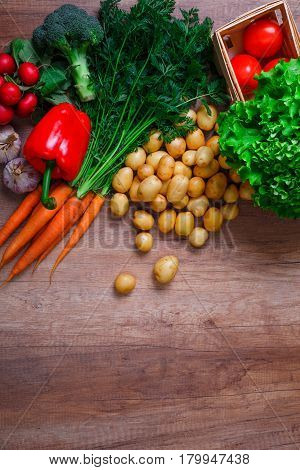 Vegetables. Potatoes, carrot and red pepper. Lettuce salad, garlic and brocoli. Red radish and tomatoes. Natural organic bio food.