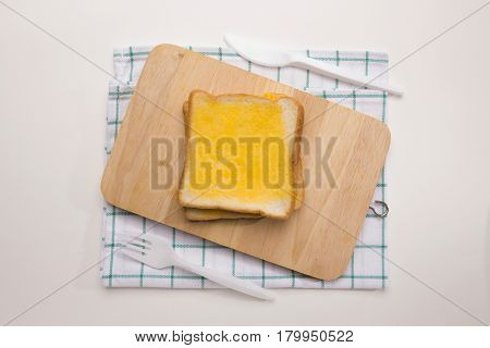 sweet toast butter with knife and fork on white background. this bread is Thai style sweetmeat.