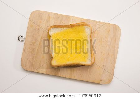 sweet toast butter on wooden chopping board on white background. this bread is thai style sweetmeat.