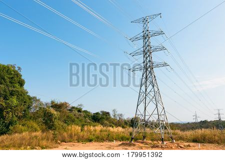 Electricity transmission power lines in the morning (High voltage tower)