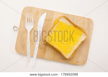 sweet toast butter meal set on wooden chopping board on white background. this bread is thai style sweetmeat.