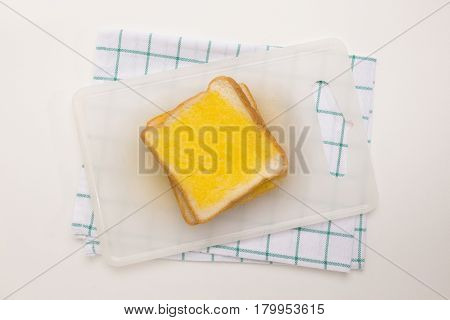 sweet toast butter meal on chopping board with green dish towel decoration on white background. this bread is thai style sweetmeat.