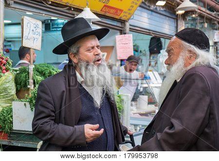 Two Undefined Orthodox Jewish Men Talking At Mahane Yehuda Market, Popular Marketplace In Jerusalem,