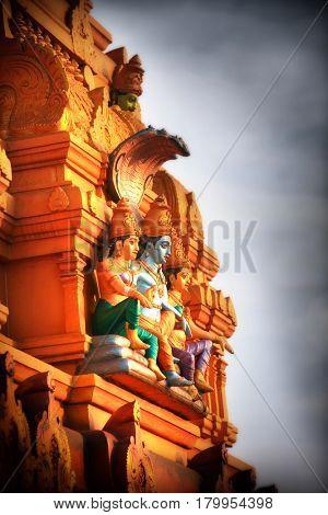 Hindu god Vishnu statue on the exterior temple wall