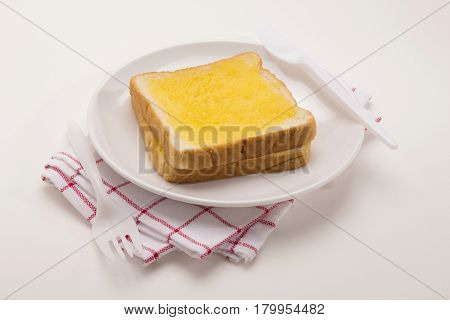 sweet toast butter plate with red pattern dish towel decoration on white background. this bread is thai style sweetmeat.