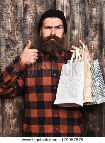 Bearded Brutal Caucasian Hipster With Moustache Holding Shopping Packages