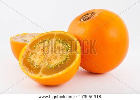 Lulo ( Solanum quitoense ) on white background