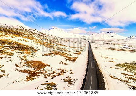 Aerial View Of Road And Snowy Mountains, Iceland