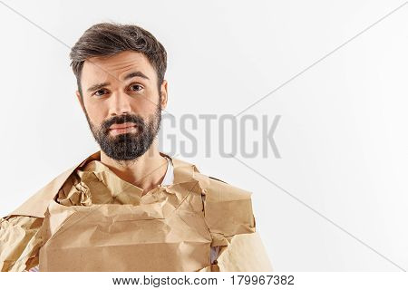 Sceptic man dressed in ecological bags is looking at camera with interest. Portrait. Isolated and copy space