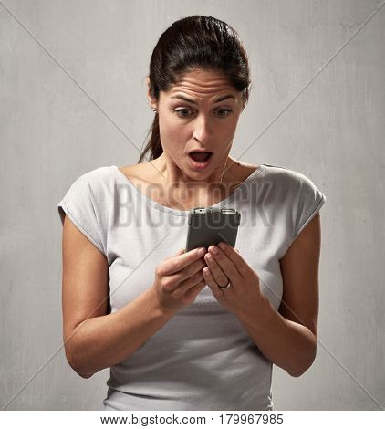 surprised uncontented woman with smartphone