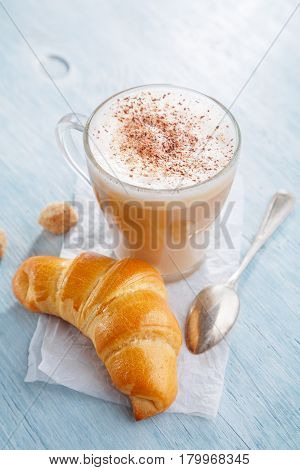 Breakfast with Latte macchiato coffee and croissant