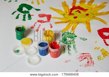 A child's drawing on the drawing paper colored finger paints