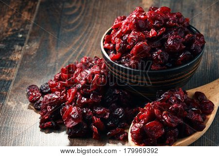 Composition With Bowl Of Dried Cranberries On Wooden Table