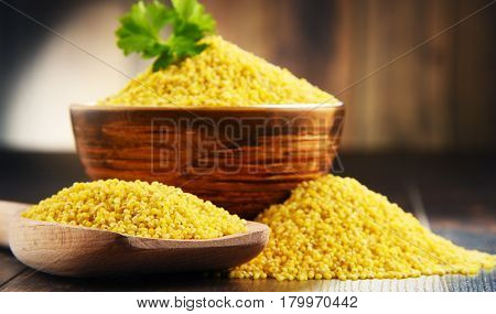 Composition With Bowl Of Millet On Wooden Table