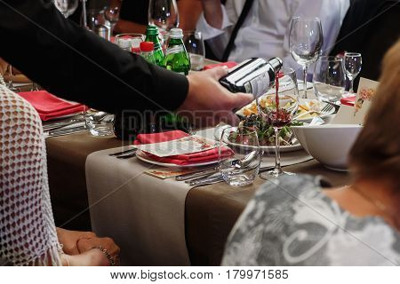 Waiter Pouring Wine Into Glass At Luxury Wedding Reception Close-up, Special Occasion Catering, Expe