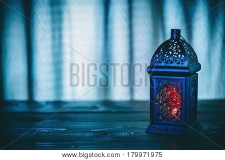 The Muslim Feast Of The Holy Month Of Ramadan Kareem. Beautiful Background With A Shining Lantern Fa