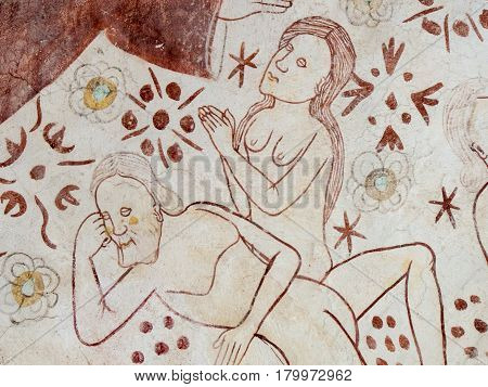God Father is blessing Adam and Eve in the paradise. A gothic fresco in Linderod church Sweden September 12 2009