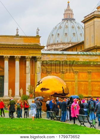 Vatican city, Italy - May 02, 2014: The Sphere within a Sphere, a bronze sculpture by Italian sculptor Arnaldo Pomodoro in the courtyard of Vatican Museum in Vatican on May 02. 2014 in Italy