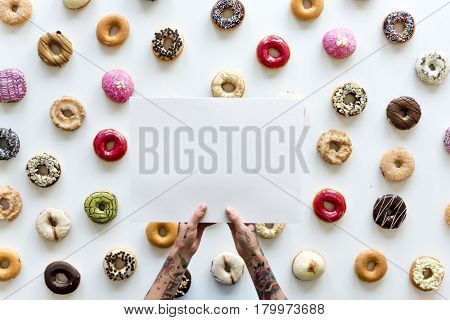 People Hands Hold Paper with Doughnuts Background