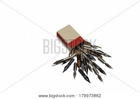 Scattered fountain pen nibs with box isolated on white