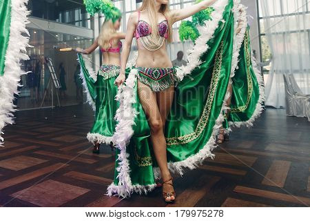 Sexy Exotic Belly Dancers In Traditional Clothes With Silk Skirts Performing At Dance Hall Event In