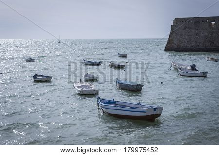 Caleta Beach and fishing boats in Cadiz Spain