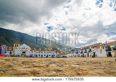 Villa de Leyva, Colombia - November 15, 2014: Central square of Villa de Leyva  with coloful buildings
