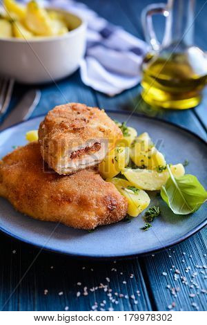 Fried Pork Cutlets Stuffed With Sun - Dried Tomato And Roquefort Cheese, Served With Potato