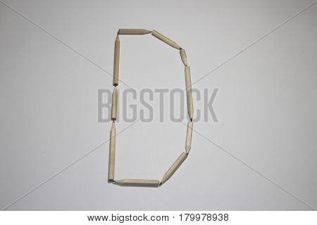 Alphabet symbol - letter D pencil on white background