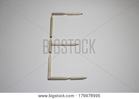 Alphabet symbol - letter E pencil on white background