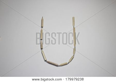 Alphabet symbol - letter U pencil on white background