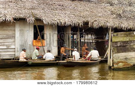 IQUITOS PERU - MARCH 17: Group of men on canoes in the Belen neighborhood in Iquitos Peru