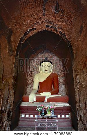 Very Beatiful Smiling Buddha Statue With Altar Inside Old Paya In Bagan, Myanmar.