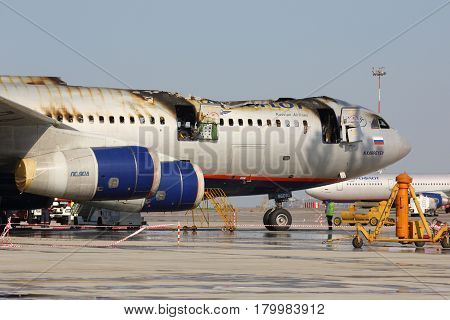 SHEREMETYEVO, MOSCOW REGION, RUSSIA - JUNE 3, 2014: Aeroflot Ilyushin IL-96-300 caught fire while standing at Sheremetyevo international airport.