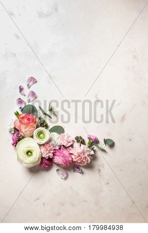 Floral round frame with  eucalyptus branches and leaves, flat lay flowers, top view with copy space