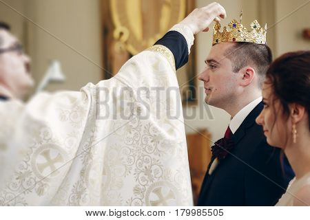 Sensual Happy Bride And Groom Wearing Gold Crowns During Wedding Ceremony In Christian Church, Coron