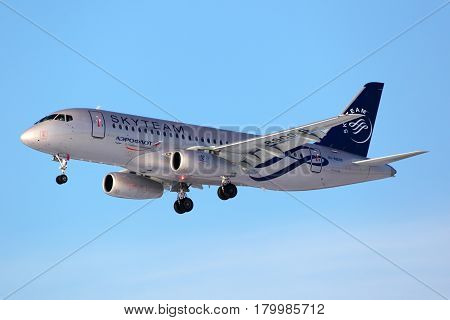 SHEREMETYEVO, MOSCOW REGION, RUSSIA - MARCH 3, 2012: Aeroflot Sukhoi SuperJet100 in SkyTeam alliance livery landing at Sheremetyevo international airport, Moscow region, Russia.