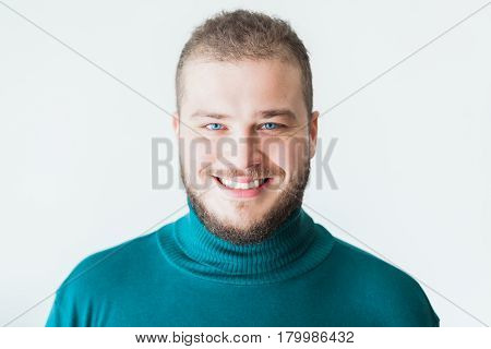 Portrait of a young bearded man smiling