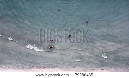 Aerial view of sup boards on the sea. Top view beachlife on a sunny day. View from above.