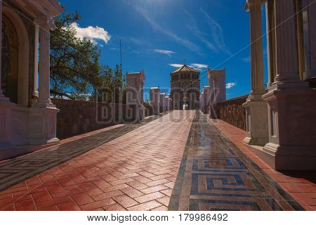 Famous orthodox monastery of Kykkos, Holy monastery of the Virgin of Kykkos in Cyprus. Way to the church near king Macarius grave. Travel sightseeing image poster