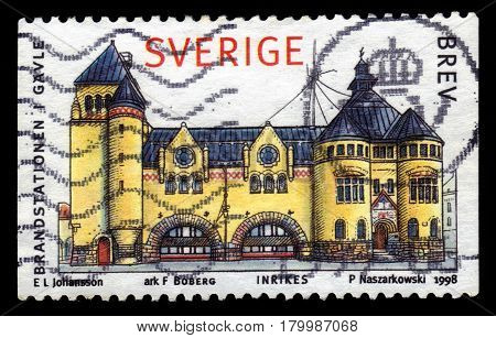 SWEDEN - CIRCA 1998: a stamp printed in the Sweden shows fire station in Gavle, series town houses, circa 1998