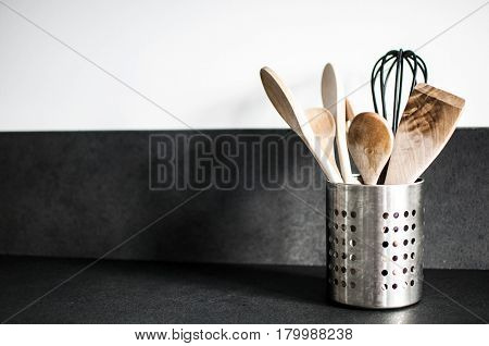 kitchen tools, ladles and wooden spoons in the kitchen