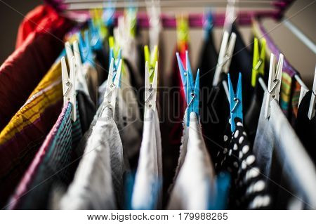 colored clothespins hanging up colored clothes for drying