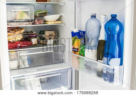 fridge full of food and drinks ready to be cooked