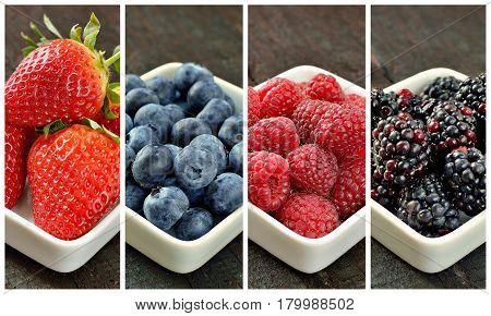 Mix of strawberries, blueberries, blackberries and raspberries fruit on wood table. Forest fruit in white idaeus. Delicious fresh berries.